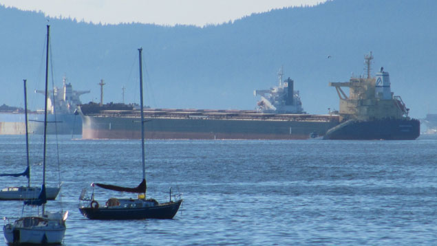 The grain freighter Marathassa at anchor in English Bay, surrounded by a boom the day after it leaked an estimated 2,700 litres of bunker fuel into the ocean.