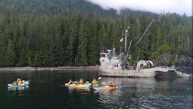 Fishing boat and kayaks. Photo: Marie OShaughnessy